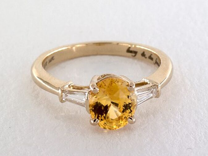 Yellow sapphire oval cut engagement ring with baguette side stones