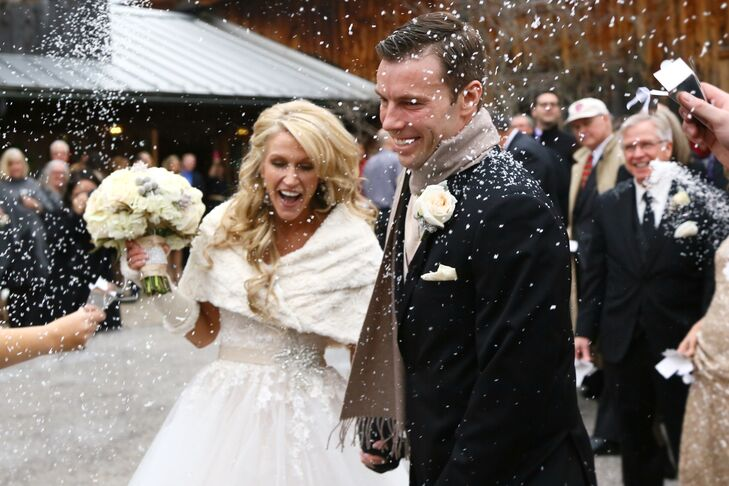 The couple exited the ceremony that took place at the Liberty Barn Church in Delaware, Ohio, and they were greeted by their guests popping confetti. Lisa wore a fur stole over her strapless wedding dress and Mark wore a scarf around his neck after the ceremony was finished, which complemented their winter-themed wedding.