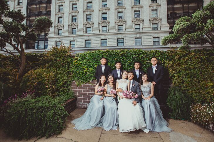 Dongli and Chengyuan posed with their wedding party dressed in blue accents. The bridesmaids wore long blue dresses with embellished bodices, while the groomsmen wore light purple bow ties with their black suits.