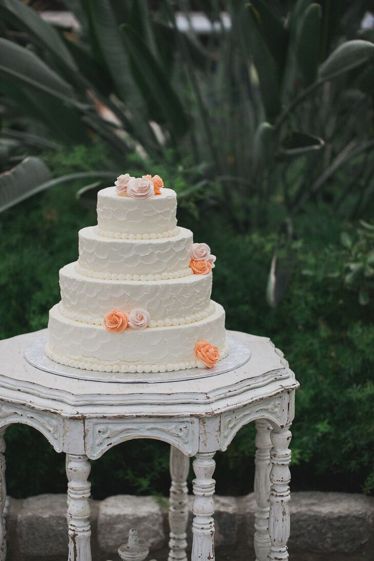 Four Tier Wedding Cake Displayed on an Antique Table