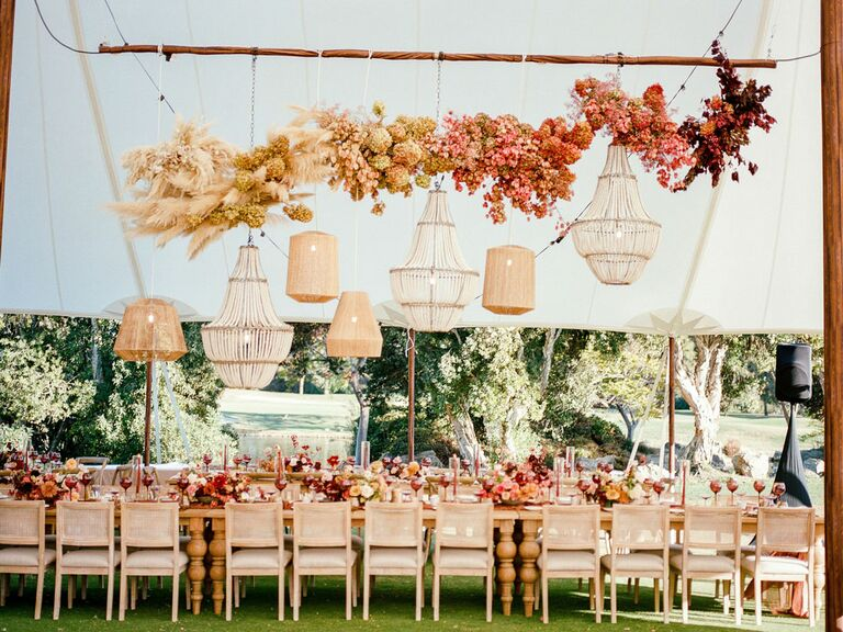 Suspended ombré floral installation at tented wedding reception