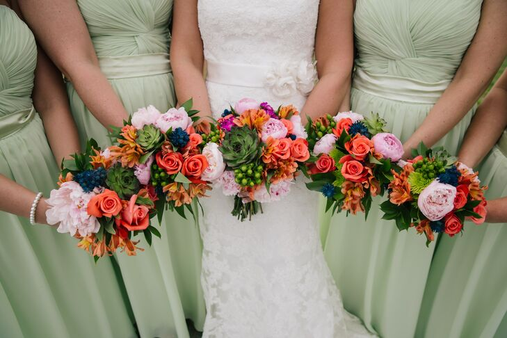 Nicole and her bridesmaids carried colorful bouquets filled with blush, fuchsia, orange, coral and green hues. Bowtanicals combined peonies, spray roses, chrysanthemums, hypericum berries, alstroemeria and edgy succulents to create this look.