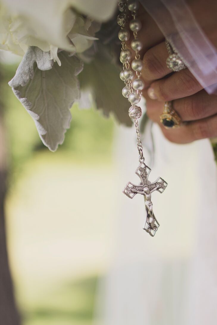 Lauren carried a rosary and charms of her late grandparents around her bouquet.