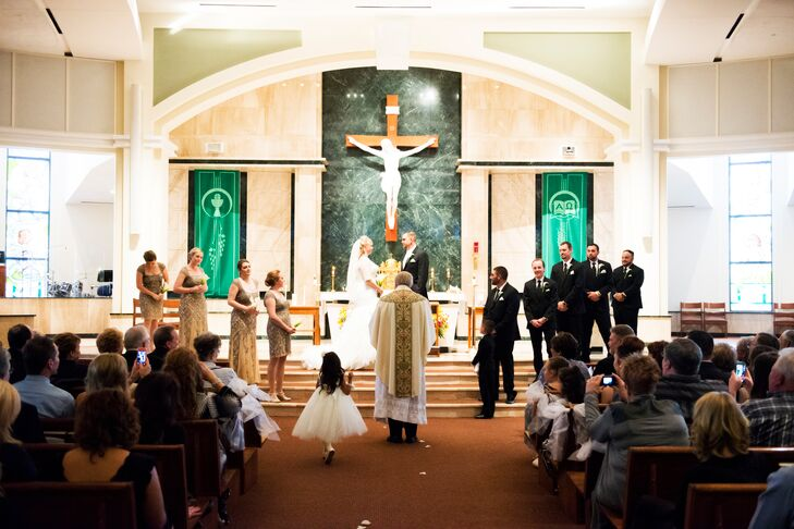 """Jessica and Tim exchanged vows at St. Thomas More Catholic Church in Centennial, Colorado. """"This was a no-brainier, as it was the church where I grew up and into my faith,"""" Jessica says. """"Tim and his family are also Catholic, so getting married in a church was never a question."""""""