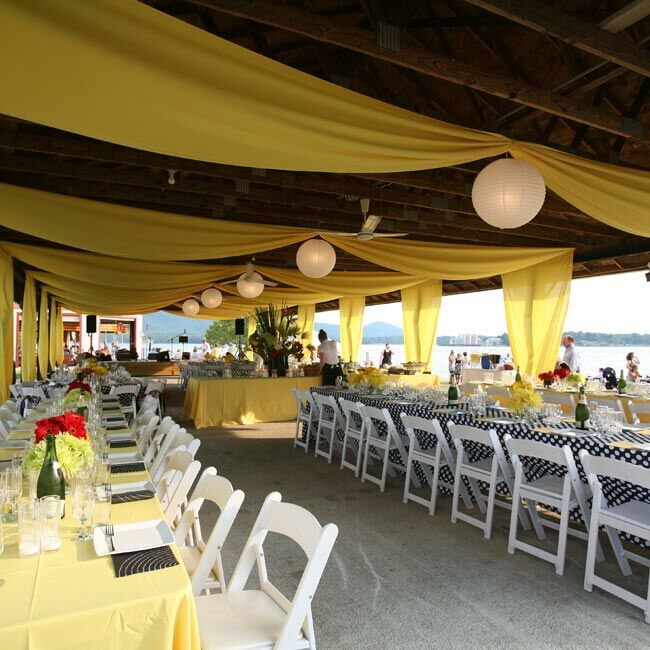 Bright fabric, paper lanterns, and vibrant linens transformed the marina's picnic-style pavilion into a cheery party space.   Linens Rental: Cloth Connection, Washington, DC