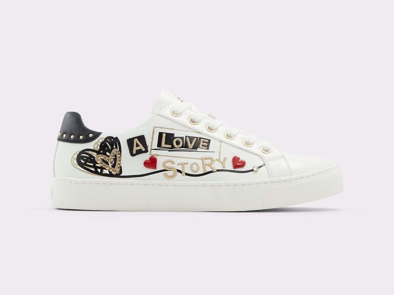 White bridal sneakers with A Love Story and heart motifs in black, red and gold