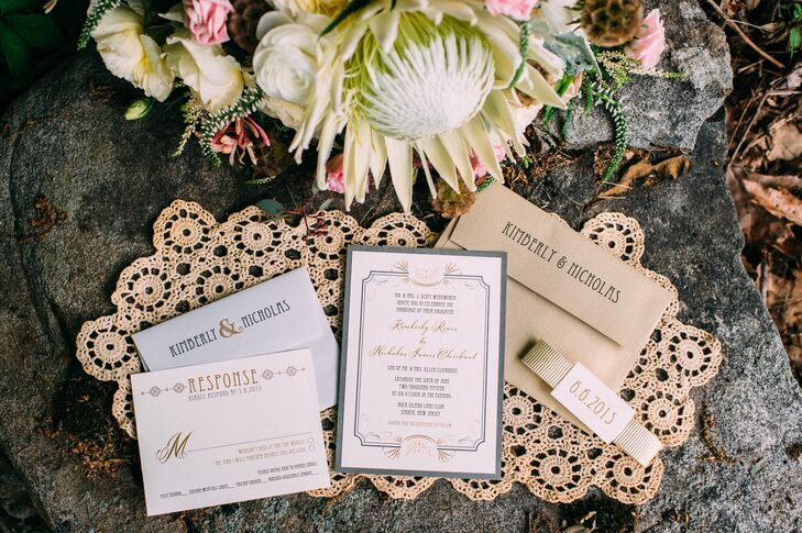 Talk about regal! The couple gave their 185 guests Beacon Lane invitations that looked as if they were welcomed to a ball. Thin black and gold alternating script filled the cards from within whimsical borders. A gold ribbon wrap brought together every piece for a fun yet sophisticated design.