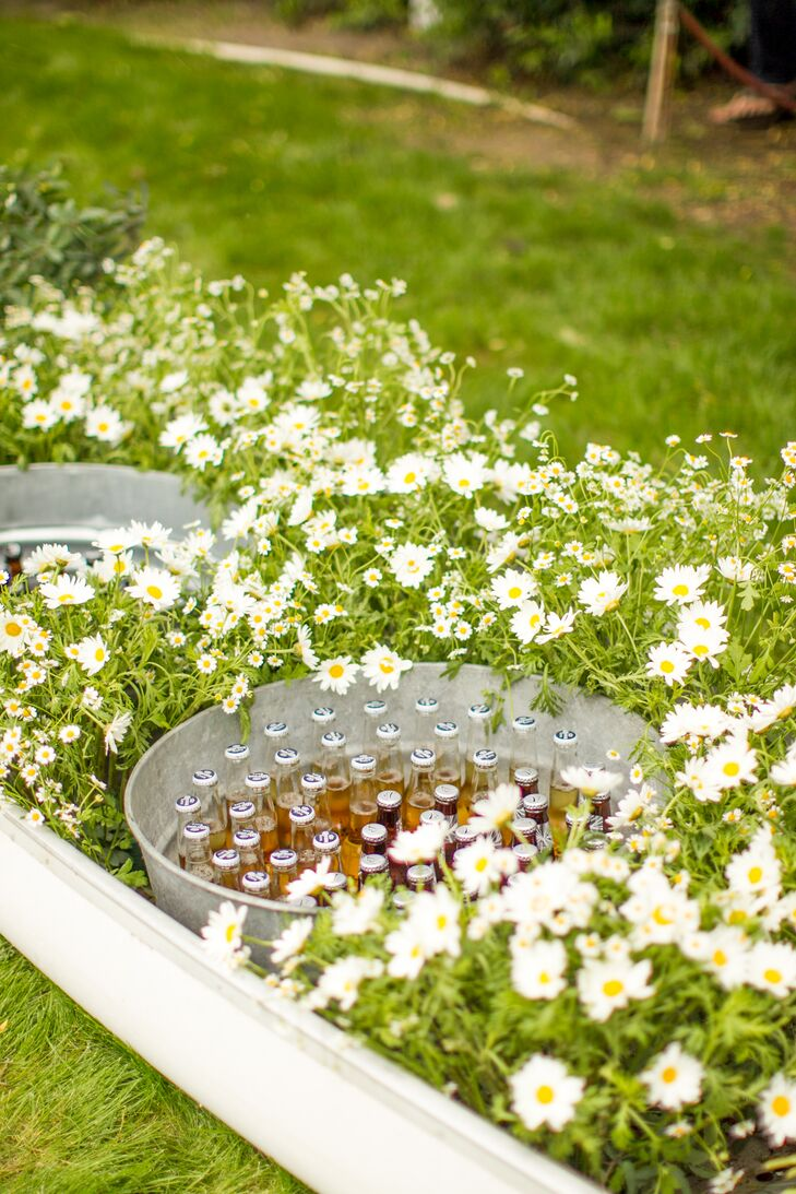 Circular Steel Beverage Tub Tucked in Daisies