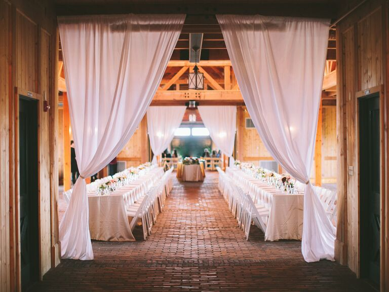 Decorated barn with curtains and tables