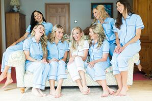 Bride with Bridesmaids Getting Ready in Matching Pajamas