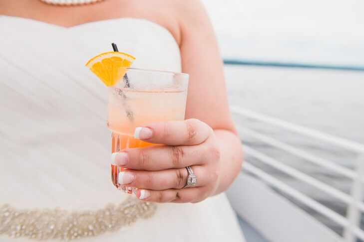 The wedding party and guests enjoyed signature orange cocktails while overlooking Lake Champlain from the cruise.