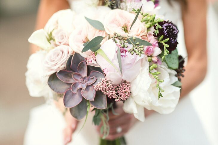 Sophisticated and romantic, Lauren's bridal bouquet featured full, classic blooms and textural elements in soft shades of white, cream, sage green and blush. Deep purple scabiosas, fiddleheads and succulents added depth and dimension to the breathtaking arrangement, as well as giving the bouquet a subtle modern edge.
