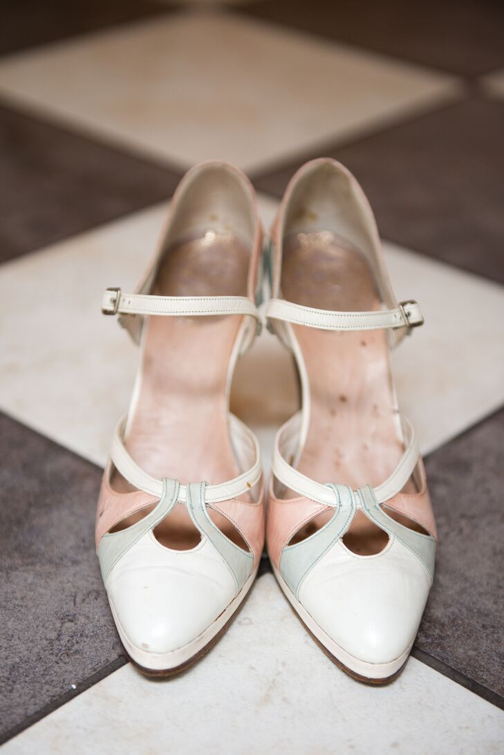 The bride accessorized with 1920s flapper heels from Paris and a 1930s celluloid floral choker.