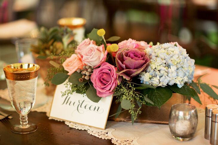 """""""I didn't want the flower arrangements to be too structured,"""" Annie says. """"I wanted them to appear almost as though they were plucked right out of the Marie Selby Gardens."""" Their florist, Tiger Lily Flowers, captured this notion with low natural, centerpieces of fuchsia, blush and peach roses alongside blue hydrangeas, greenery and eucalyptus that overflowed from gold breakaway vases."""