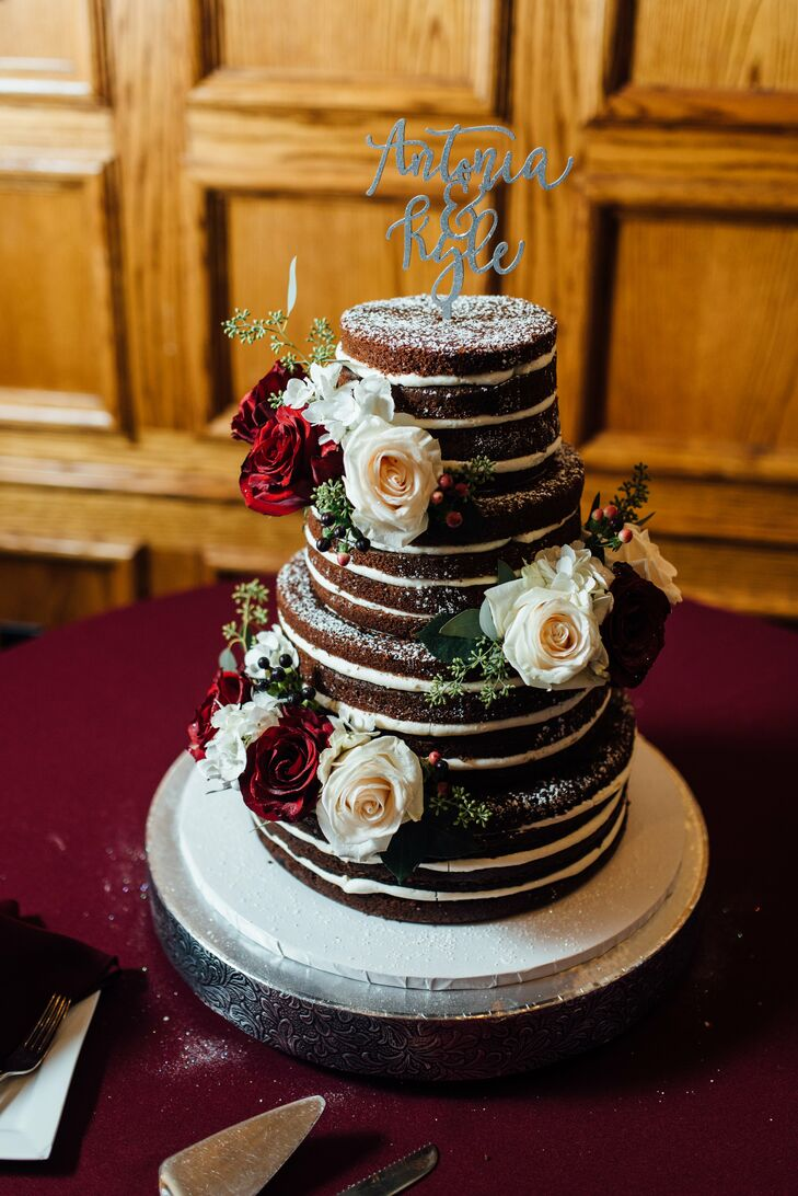 After dinner, Elizabeth and West treated their guests to a slice of blueberry velvet cake with cream cheese frosting. The four-tier naked confection was lightly dusted in powdered sugar and decorated with fresh roses and a whimsical silver cake topper bearing their names.