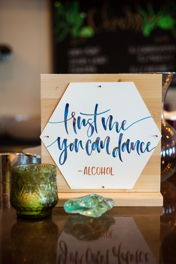 Calligrapher L Shannon Designs crafted all the signs for the event, including this playful piece (placed at the reception's bar).