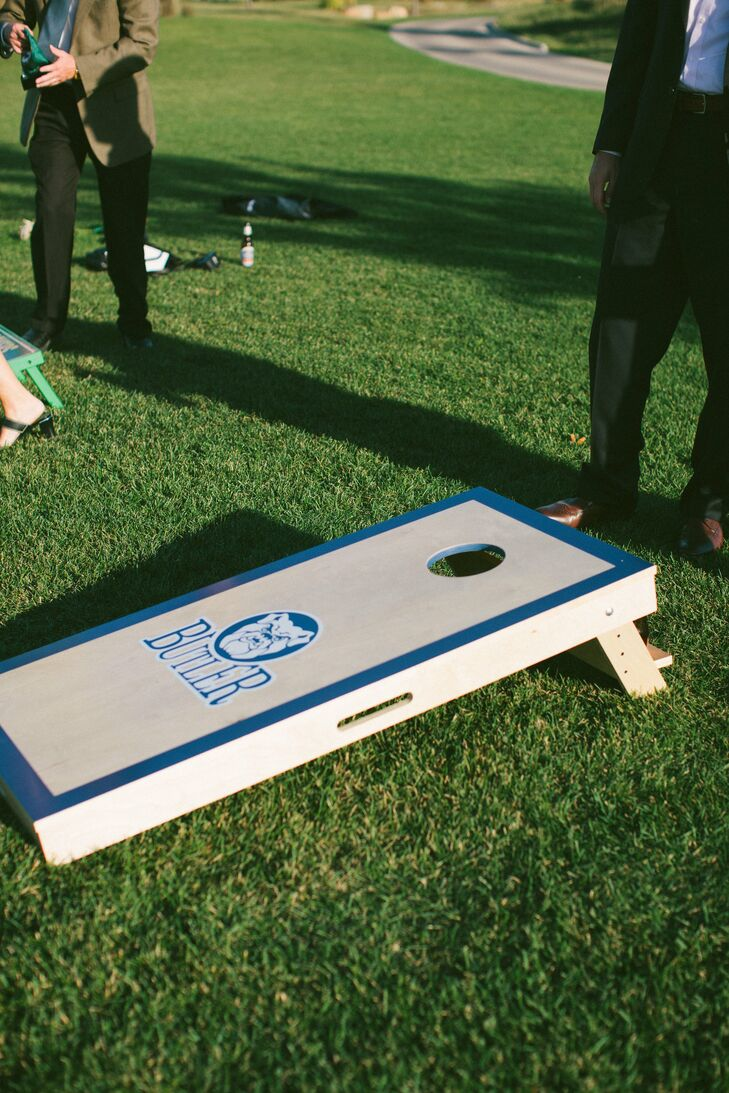 During the cocktail hour, guests enjoyed peach sangria (the signature cocktail) while playing lawn games. Allison's brother surprised the couple with a custom Butler University (the couple's alma mater) corn hole set as a wedding gift.
