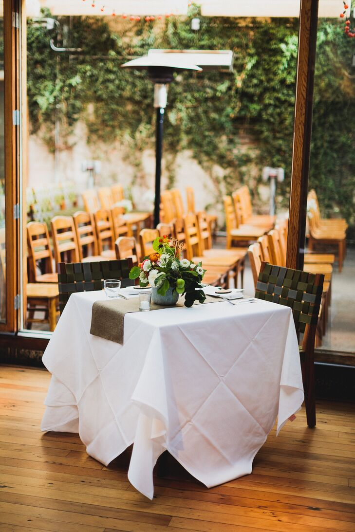 White Sweetheart Table with Floral Centerpiece