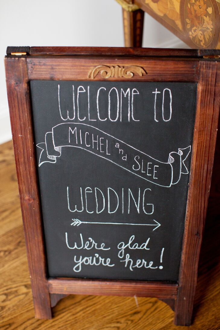 """The couple said """"I do"""" outside at the Trump Winery, and the reception was held under the vineyard's beautiful pavilion. They welcomed guests with a rustic chalkboard sign directing guests where to go on the immense, vineyard property."""
