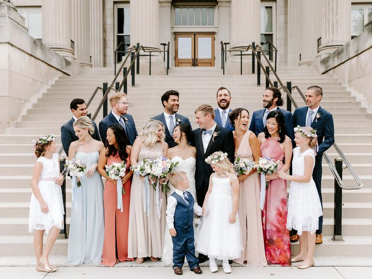 Bride and groom with wedding party and ring bearer and flower girl