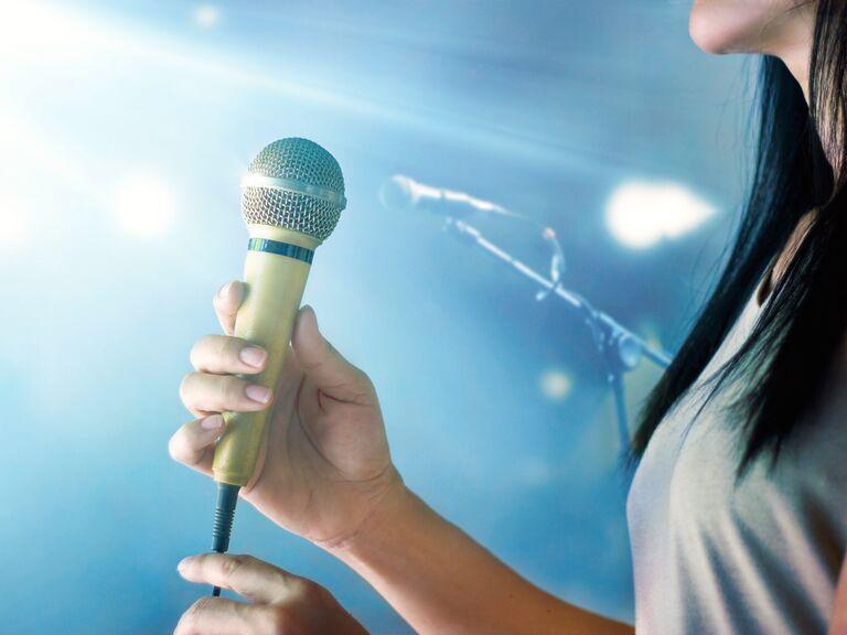 MC holding microphone