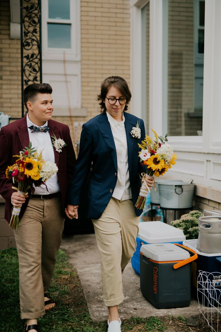 Couple Holding Hands During Backyard Wedding in Detroit, Michigan