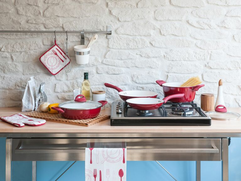 red pots and pans in kitchen on counter and stove