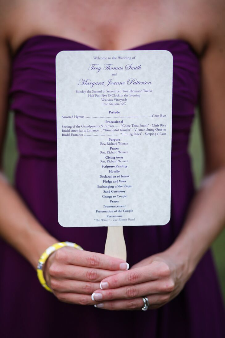 Jeannie and Troy turned their programs into fans for the outdoor ceremony in the summer. The subtle, elegant printed paper set the tone, while the purple typography fit the white, purple and yellow color scheme.