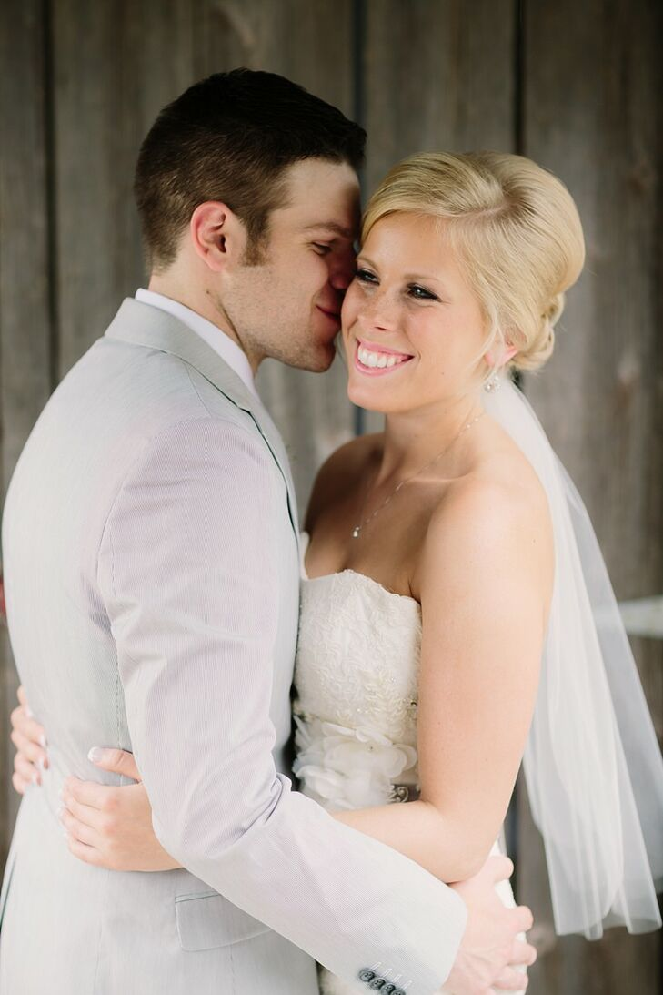 Erin wore her hair in a low, parted updo, which she accessorized with an elbow-length veil and minimal jewelry. For an extra pop of color, she wore pale pink lipstick to match her bridesmaids and bridal bouquet.