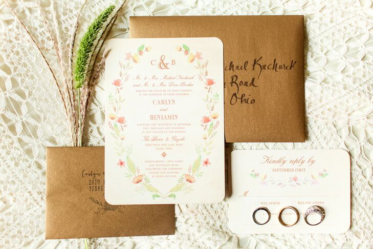 Wedding Paper Divas designed the invitations that reflected the simply natural wedding day. An elegant floral design circled around the red text revealing the day's details.
