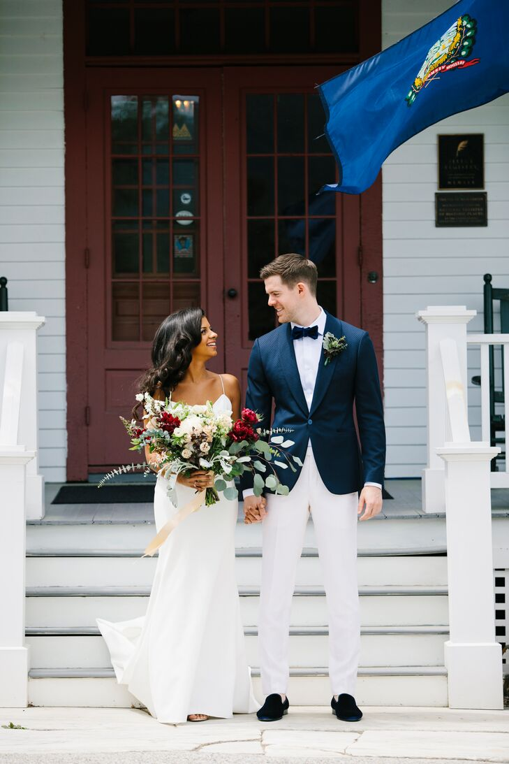 Seasonal blooms, a welcoming red barn backdrop and a mint-green doughnut cart lent Katie Stockton and Brian Neilsen's summer fete a romantic yet laid-