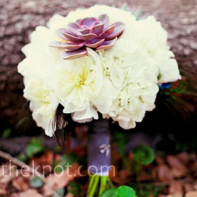 Holly carried white peonies, orchids, and succulents in her wedding bouquet.