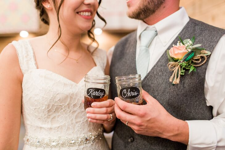 Karley and Christopher toasted with personalized vintage mason jars.