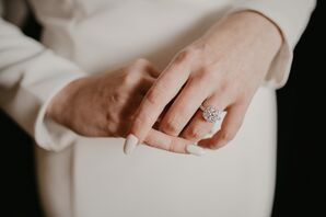 Bride with Manicure and Cushion Cut Engagement Ring