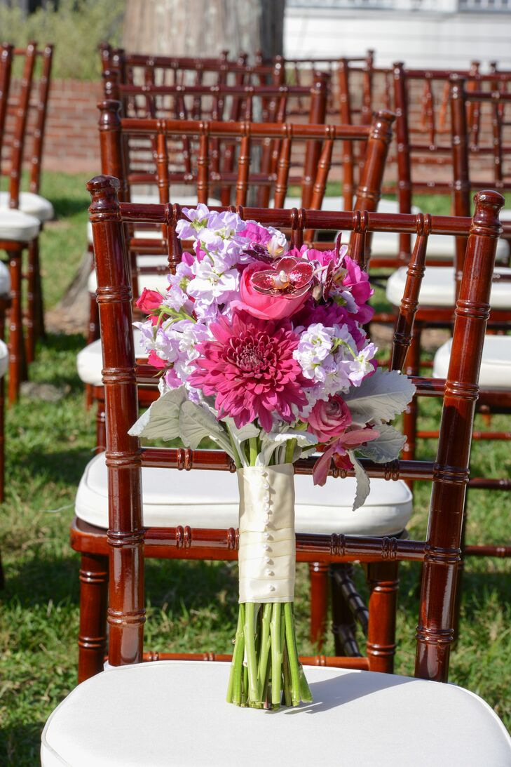 Wanting a bouquet of spring flowers for their March wedding, Juliana walked down the aisle with a bouquet of pink and lavender orchids, dahlias and ranunculus accented with dusty miller. It was arranged by flores y ambientes.