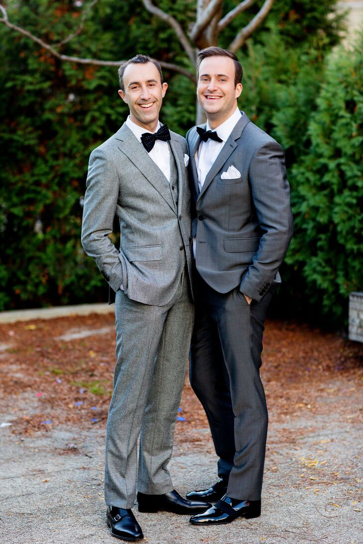Michael wore a gray Burberry suit and accessories from the Tie Bar; Eric wore a gray plaid suit from SuitSupply with accessories from the Tie Bar.