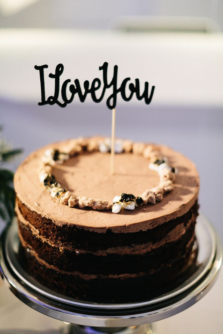 """In lieu of traditional cake toppers, Liz and Adam infused their Momofuku Milk Bar wedding cakes with a bit of movie magic, adorning each with """"Star Wars"""" characters Han and Leia, in addition to their iconic quotes."""