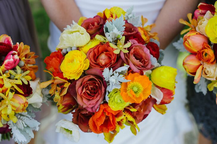 Roses, ranunculus, orchids, anemones and tulips filled the bright, cheerful bridal bouquet.