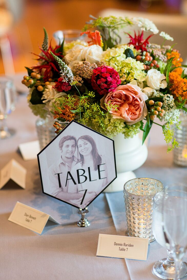 Colorful mixes of berries and blooms, all in shades of orange, peach and white, were placed in milk glass vases on the reception tables.