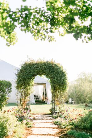 Arch Pathway with Greenery Leading to Reception