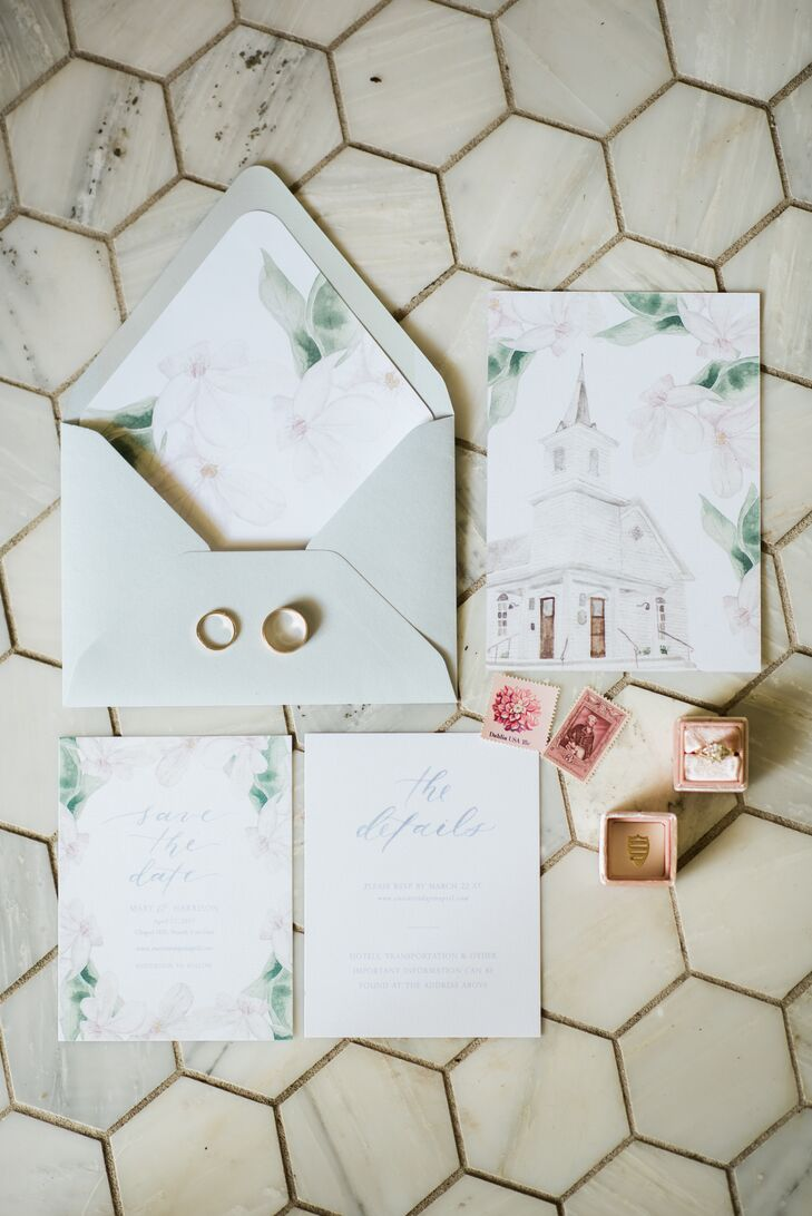Watercolor invites incorporated a painting of the chapel and beautiful blooms, setting a sophisticated tone for their wedding.
