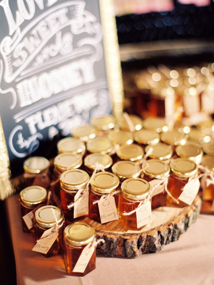 As a thank you to their guests for their love and support, Kristina and Joe sent their guests home with jars of locally made honey. Each jar was dressed up with a handmade tag featuring the wedding's antler motif.