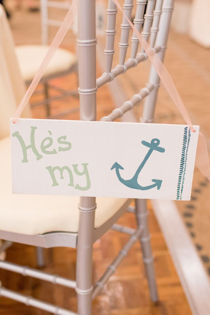 "No detail was overlooked when it came to the reception decor, with Gina and Steven incorporating their nautical theme into everything from the color palette to the favors and signs. To set their seats apart from the rest, the couple placed hand-painted signs on the backs of their chairs with playful sayings like ""He's my anchor,"" and ""She's the wind in my sails."""