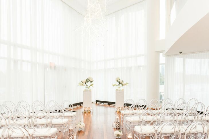 Glamorous Ceremony Site with White Draping, Ghost Chairs and Aisle Decorations