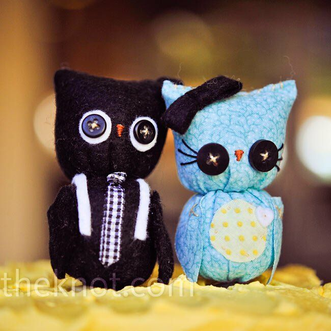 A designer on Etsy.com custom-made the couple's arts-and-crafts-style cake topper. The groom owl even had white suspenders!