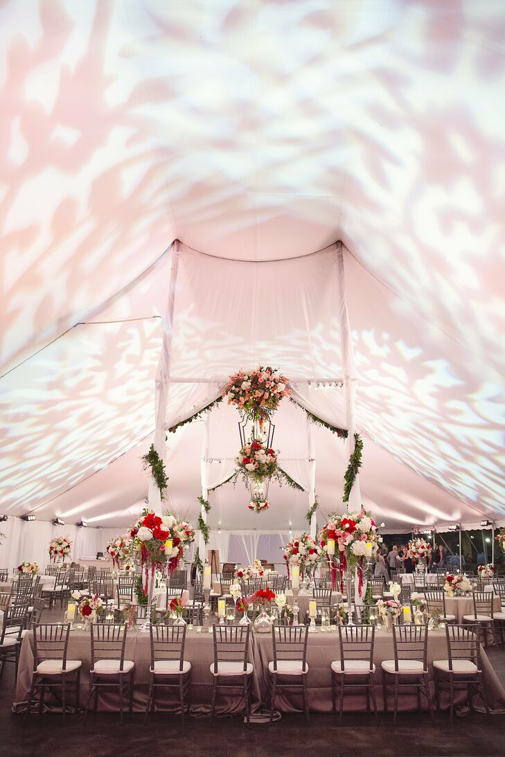 Lush floral arrangements and decked-out chandeliers decorated the inside of the couple's tented reception.