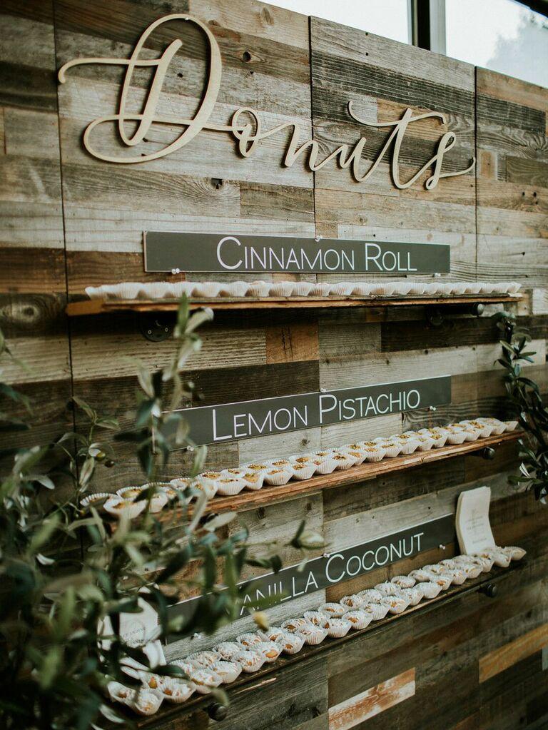 Rustic doughnut wall at wedding reception