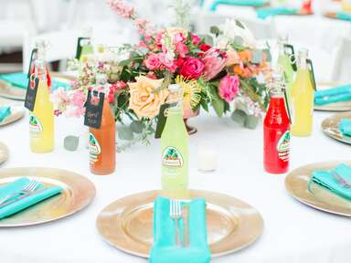 Jarritos soda bottles on wedding reception table