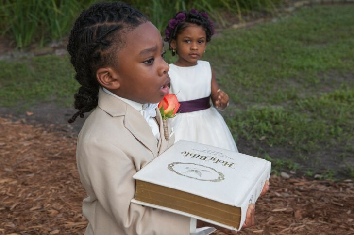 Young members of Sasha's family participated in the ceremony by carrying the bible down the aisle.