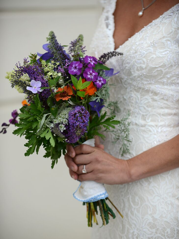 Rebekah and Josh chose their color palette based on their colleges' school colors, both of which happened to be purple. For her bouquet, Rebekah chose a mix of bright purple wildflowers, lots of greenery and few pops of orange.